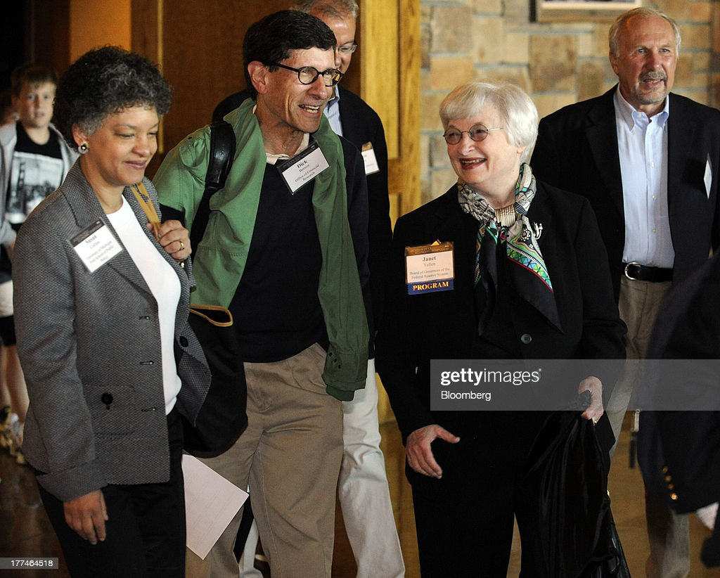 Susan Collins, dean of the University of Michigan, left, Richard Berner, director of the office of financial research for the U.S. Treasury, center, and Janet Yellen, vice chairman of the Federal Reserve, second from right, chat as they arrive at the Jackson Hole economic symposium, sponsored by the Kansas City Federal Reserve Bank, at the Jackson Lake Lodge in Moran, Wyoming, U.S., on Friday, Aug. 23, 2013. The U.S. central banks bond buying is a less potent tool for stimulating growth than policy makers believe, two economists said in a paper released today at a Federal Reserve conference. Photographer: Price Chambers/Bloomberg via Getty Images