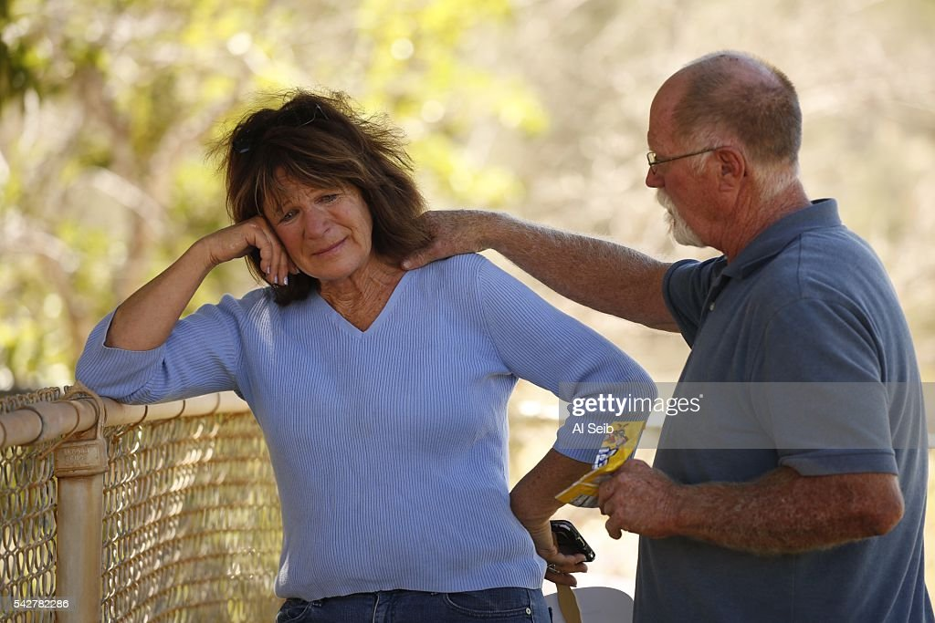 Susan DeFussi, is comforted by her partner, Mike Cargill, at the Red Cross evacuation Center in Kernville Friday, June 24, 2016. DeFussi and Cargill had to run for their lives and lost their home in the Cooks Peak area of Squirrel Valley to the raging Erskine fire. More than100 structures have been lost in a fast-moving brush fire that broke out in a rural area of Kern County.