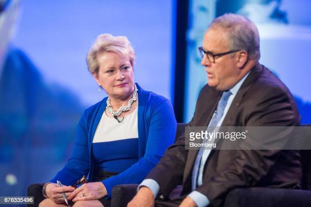 Susan Dentzer chief executive officer of Network for Excellence in Health Innovation left listens as John Lechleiter former president and chief...