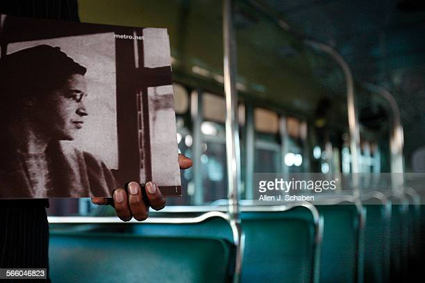 Susan Dove cochair of the African American Employees Association at Matropolitan Transportation Authority holds a Rosa Parks poster as she tours a...