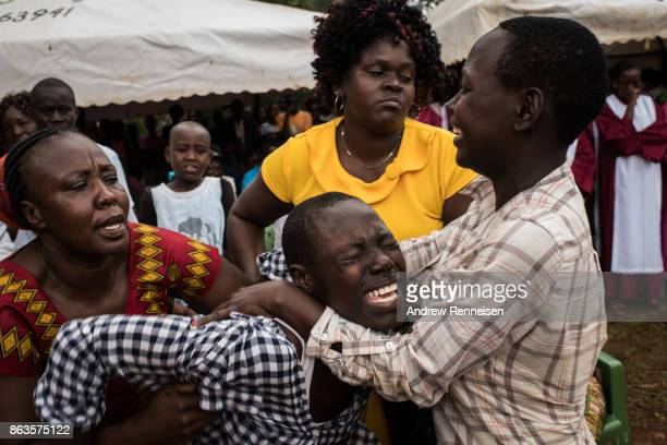Susan Duong'a cries during the funeral service for her brother Edward Ochieng Odhiambo who was one three men killed by the police in an opposition...