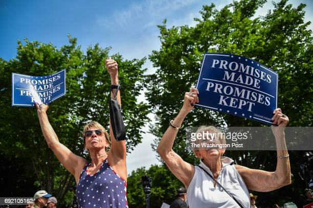 Susan Ferreri of Powhatan VA left and her mother Martha Ann Wages join others during Pittsburgh not Paris March in support of President Donald Trump...