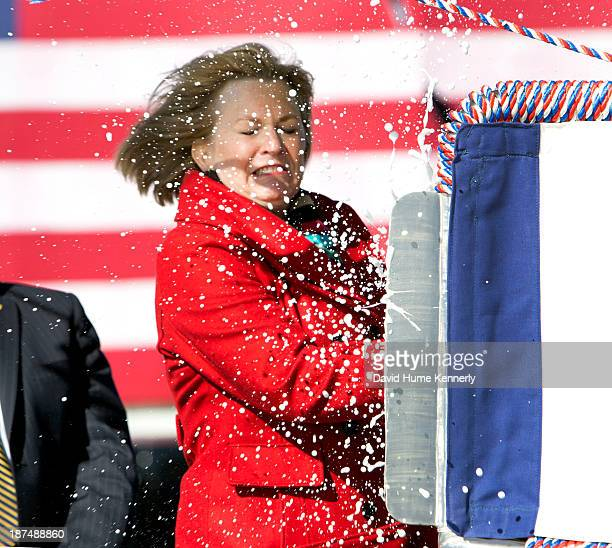 Susan Ford Bales breaks a bottle of champagne on the bow of the USS Gerald R Ford at its christening ceremony November 9 2013 in Newport News...