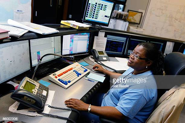 Susan Frazier the energy systems dispatcher keeps on eye on her computer screens in the control room of the Gainesville Regional Utilities April 15...