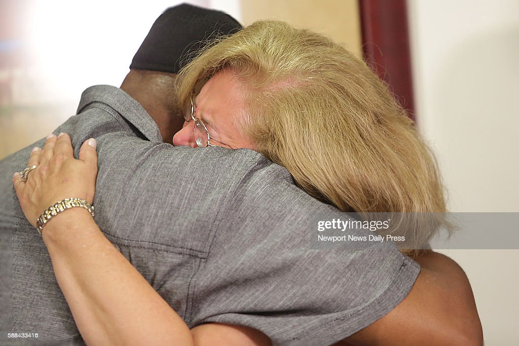 Susan Hanson and Jerry Hayes hug as they meet for the first time Hayes received her organ donor son's heart