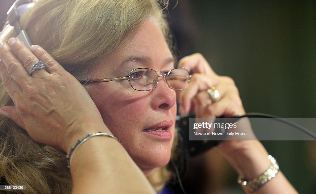 Susan Hanson concentrates as she hears the heartbeat of her son an organ donor in the chest of Jerry Hayes