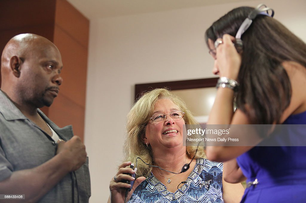 Susan Hanson middle holds the listening device so her daughter Hannah Gill can hear the heartbeat of her brother Jordan Gill which now beats in the...