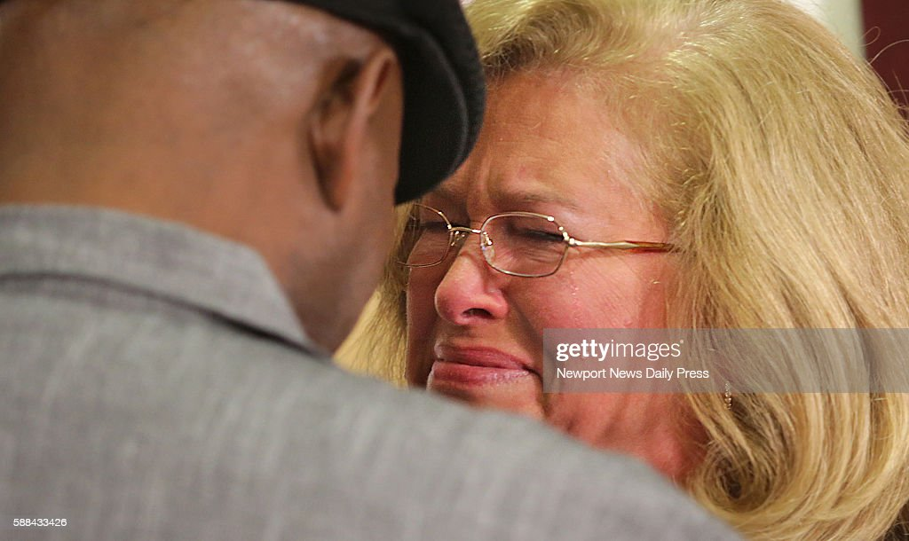 Susan Hanson right wells up as she meets Jerry Hayes who received her son's heart