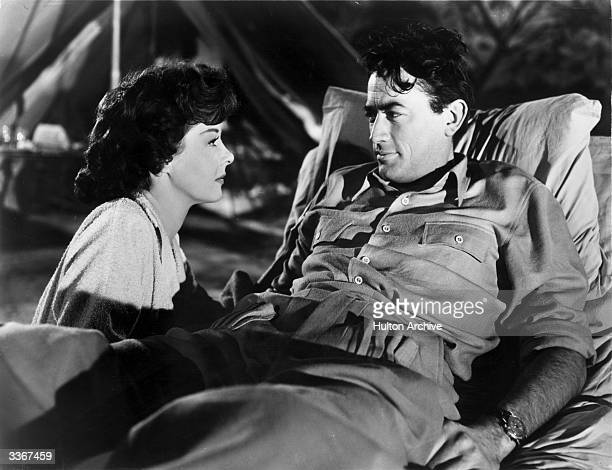 Susan Hayward and Gregory Peck in a scene from 'Snows Of Kilimanjaro' based on Ernest Hemingway's story of a wounded hunter in Africa looking back...