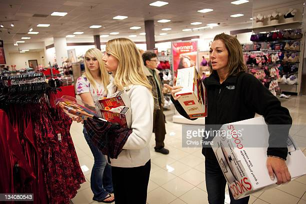 Susan Ihry Madison Sager and Jocelyn Sager make their way through the West Acres Mall JCPenney store after 3 am on November 25 2011 in Fargo North...