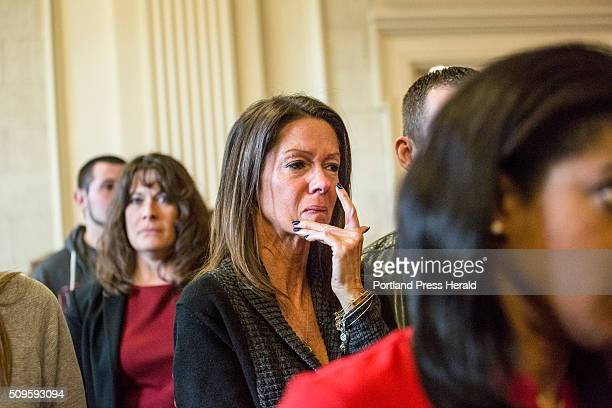 Susan Johnson wipes a tear from her cheek as James Pak receives two life sentences in the murder of her son Derrick Thompson and his girlfriend...