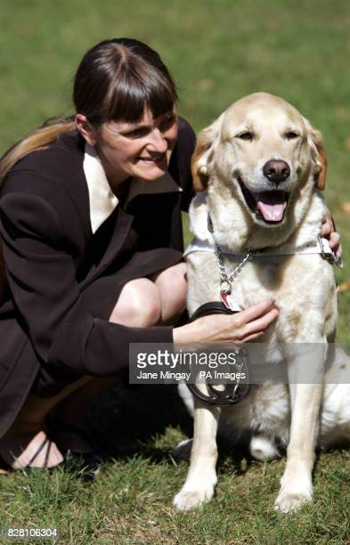 Susan Jones from Warrington with nineyearold labrador retriever cross guide dog Vaughn after he was crowned Guide Dog of the Year at the Kennel Club...