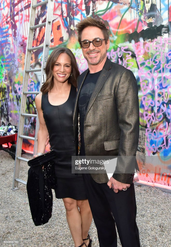 Susan Levin and Robert Downey Jr. attend Fly Into The Sun: The 24th Annual Watermill Center Summer Benefit The Watermill Center on July 29, 2017 in Water Mill, New York.