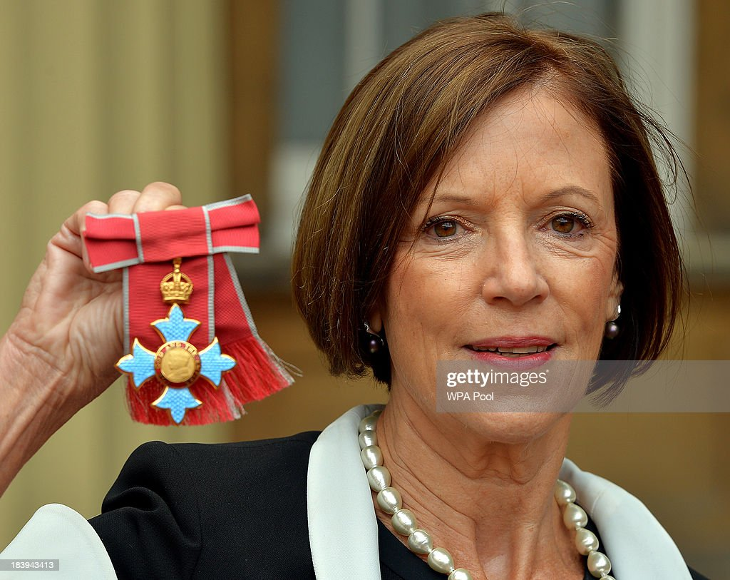 Susan Lloyd-Roberts holding her CBE for services to Journalism after it was presented to her by Queen Elizabeth II at an Investiture Ceremony at Buckingham Palace on October 10, 2013 in London, England.