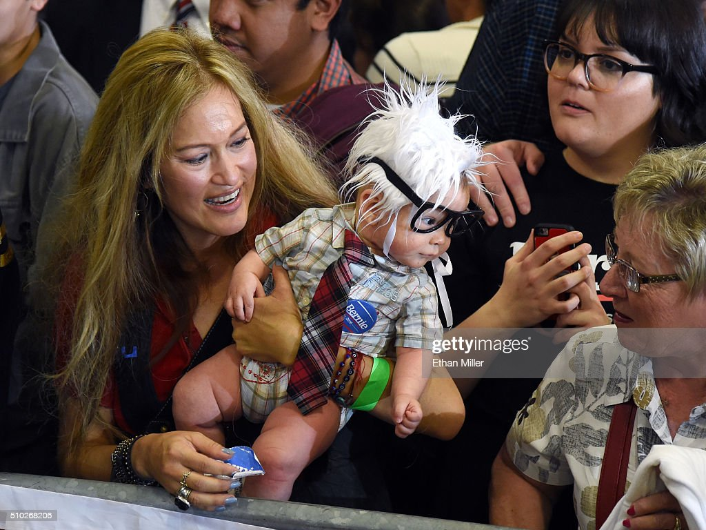 Susan Lomas (L) of Nevada holds her 3-month-old son Oliver Lomas, dressed as Democratic presidential candidate Sen. Bernie Sanders (I-VT) during his campaign rally at Bonanza High School on February 14, 2016 in Las Vegas, Nevada. Sanders is challenging Hillary Clinton for the Democratic presidential nomination ahead of Nevada's Feb. 20 Democratic caucus.