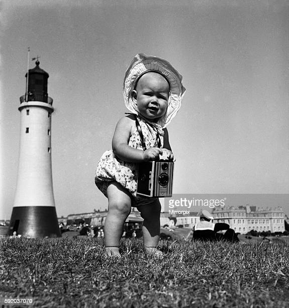 Susan May seen here with her mother's camera on Plymouth Hoe June 1950 O24582001