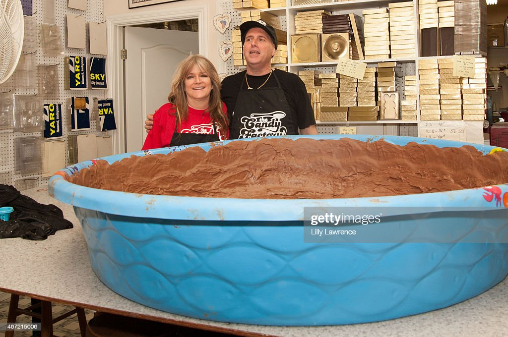 Susan Olsen helps Frank Sheftel owner of The Candy Factory attempt World Record for The World's Largest Peanut Butter Cup at The Candy Factory on March 21, 2015 in North Hollywood, California.