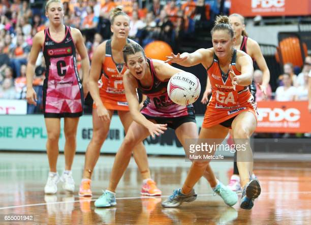 Susan Pettitt of the Giants and Fiona Ehemann of the Thunderbirds contest possession during the round five Super Netball match between the Giants and...