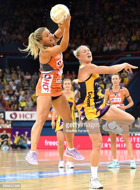 Susan Pettitt of the Giants and Laura Langman of the Lightning challenge for the ball during the Super Netball Grand Final match between the...