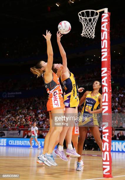 Susan Pettitt of the Giants competes with Karla Mostert of the Lightning during the round 14 Super Netball match between the Giants and the Lightning...