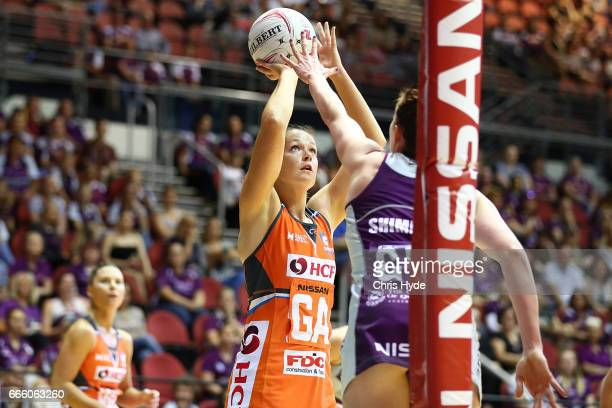 Susan Pettitt of the Giants shoots during the round eight Super Netball match between the Firebirds and the Giants at Gold Coast Convention Centre on...