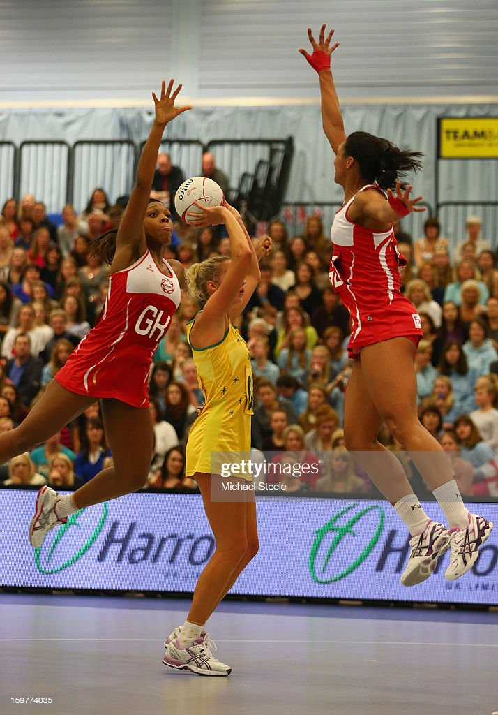 Susan Pratley (C) of Australia manages to shoot despite the challenge of Eboni Beckford-Chambers (L) and Ama Agbeze (R) of England during the England v Australia International Netball Series match at the University of Bath on January 20, 2013 in Bath, England.