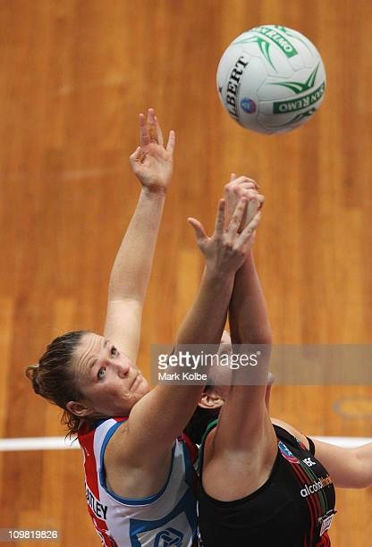 Susan Pratley of the Swifts and Johannah Curran of the Fever compete for the ball during the round four ANZ Championship match between the Sydney...