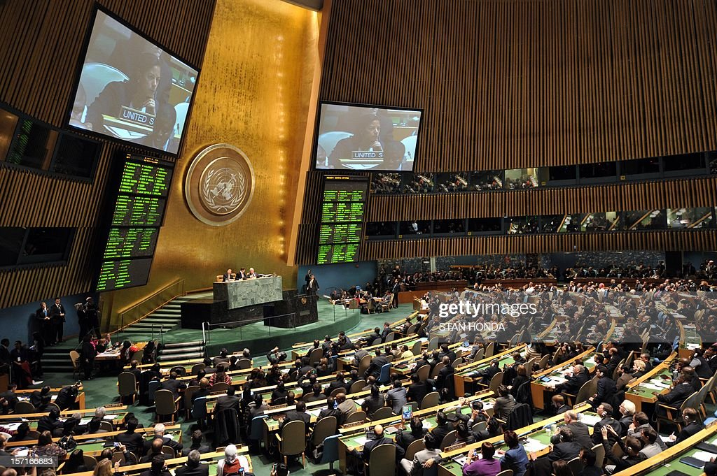 Susan Rice, United States Ambassador to the United Nations, is seen on the television screens during the United Nations General Assembly vote on a resolution to upgrade the status of the Palestinian Authority to a nonmember observer state November 29, 2012 at UN headquarters in New York. AFP PHOTO/Stan HONDA