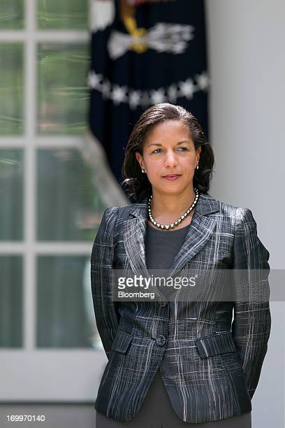 Susan Rice US ambassador to the United Nations and US President Barack Obama's nominee as national security advisor listens as Obama not pictured...