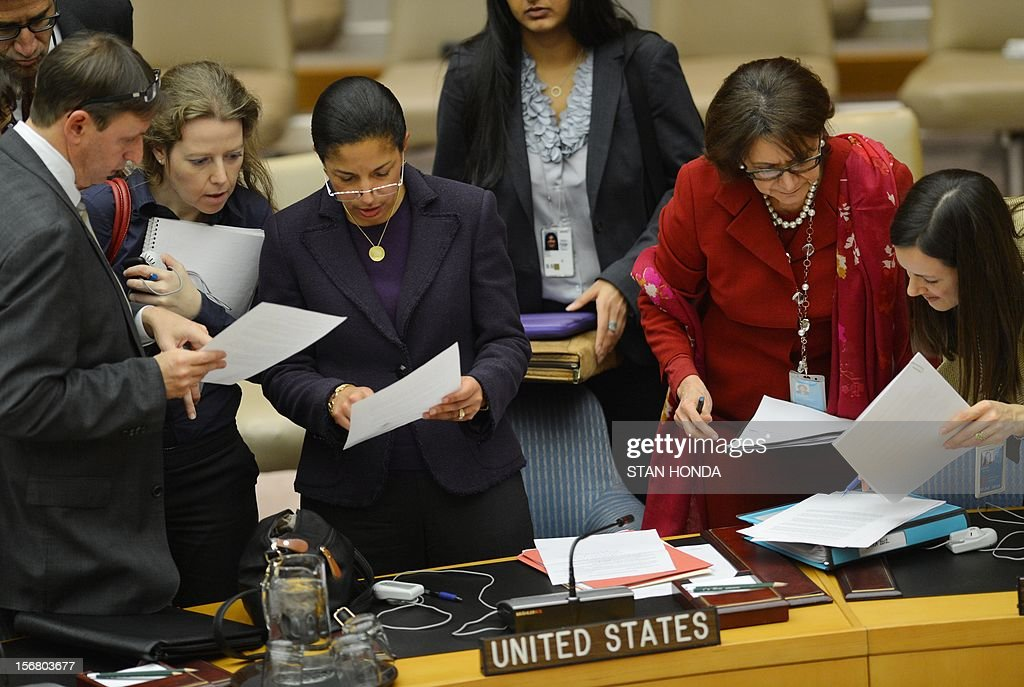Susan Rice (3rd L), US Ambassador to the United Nations, looks over a document with aides after the UN Security Council was briefed via video by UN Secretary General Ban Ki-moon on the situation in Gaza November 21, 2012 at UN headquarters in New York. Ban Ki-moon on Wednesday welcomed a truce between Israel and Hamas to end bloodshed that has killed more than 150 people, but said that details of the deal still need to be ironed out. AFP PHOTO/Stan HONDA