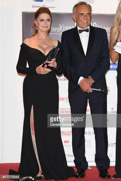 Susan Sarandon and festival director Alberto Barbera pose with the award at the Kineo Diamanti Awards during the 74th Venice Film Festival at...