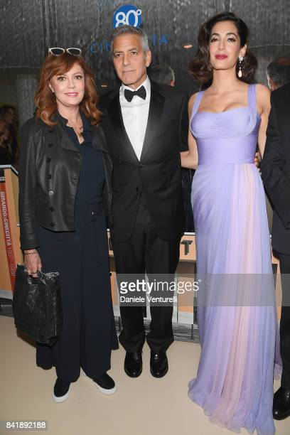 Susan Sarandon George Clooney and Amal Clooney attend the 'Hollywood Foreign Press Association Cocktail Party' during the 74th Venice Film Festival...