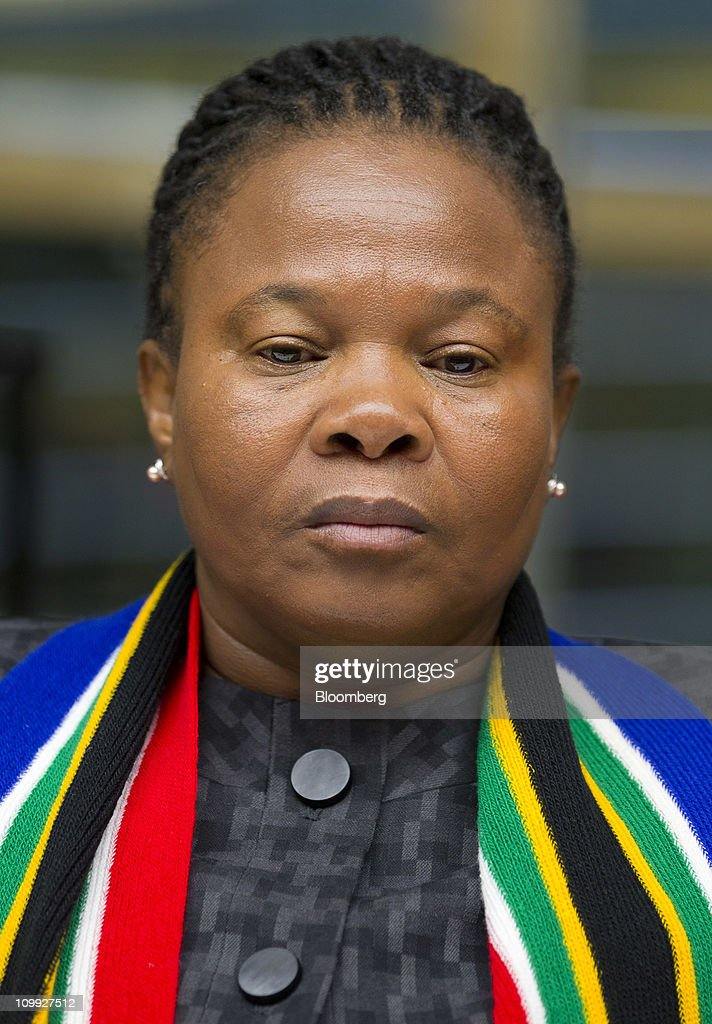 Susan Shabangu, minister of mining for South Africa, listens during an interview in New York, U.S., on Thursday, March 10, 2011. The government needs to 'revisit' disputes about overlapping mining licenses as part of a review of South Africa's new Mining Act, Shabangu said last month. Photographer: Jin Lee/Bloomberg via Getty Images