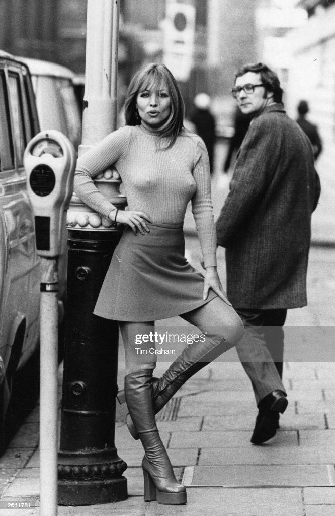 Susan Shaw models a mini skirt and platform boots.