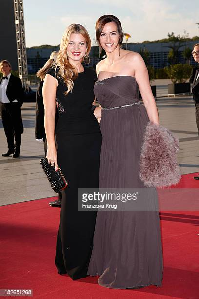 Susan Sideropoulos and Ulrike Frank attend the Deutscher Fernsehpreis 2013 Red Carpet Arrivals at Coloneum on October 02 2013 in Cologne Germany