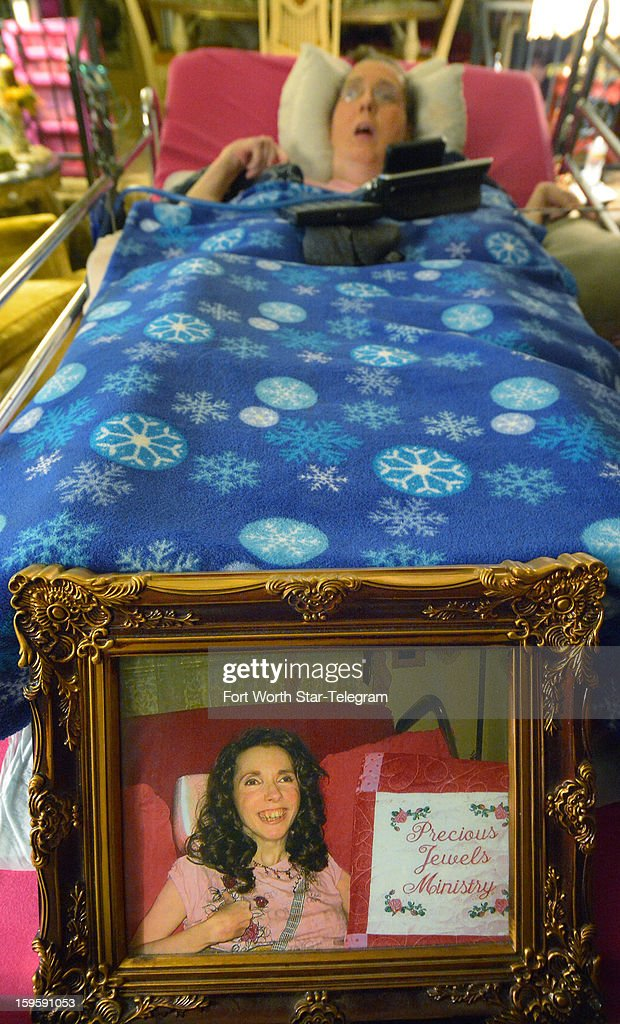 Susan Slade is pictured January 9, 2013, in her bed at her grandmother Helen Young's home in Hurst, Texas, from which she as an ordained minister counsels people by phone through her own Precious Jewels ministry.
