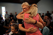 Susan Stephens right gets a hug from Karen Castelloes facing before a vigil and prayer service is held at Joy Meropolitan Community Church very close...