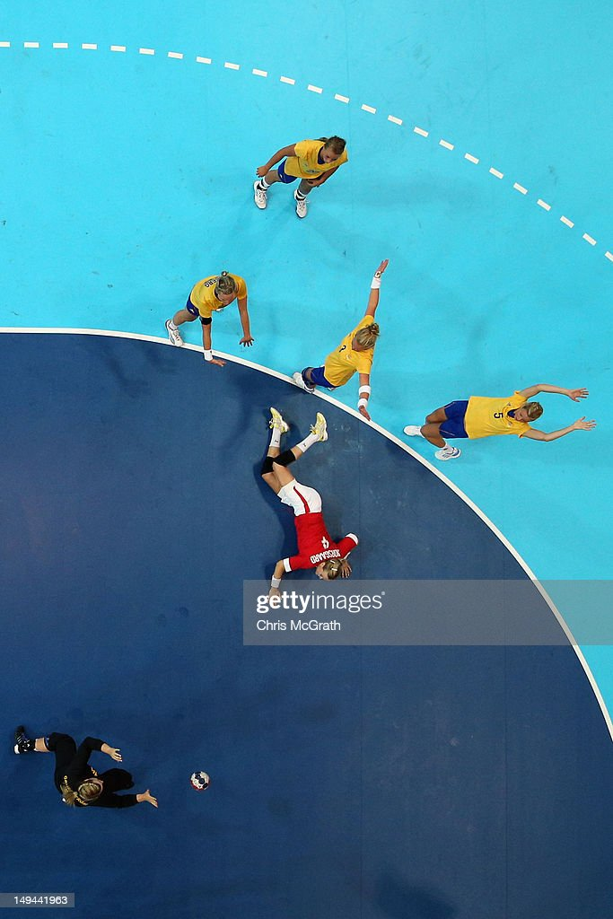 Susan Thorsgaard of Denmark is fouled by Sweden in the Women's Handball preliminaries Group B - Match 4 between Denmark and Sweden on Day 1 of the London 2012 Olympic Games at the Copper Box on July 28, 2012 in London, England.