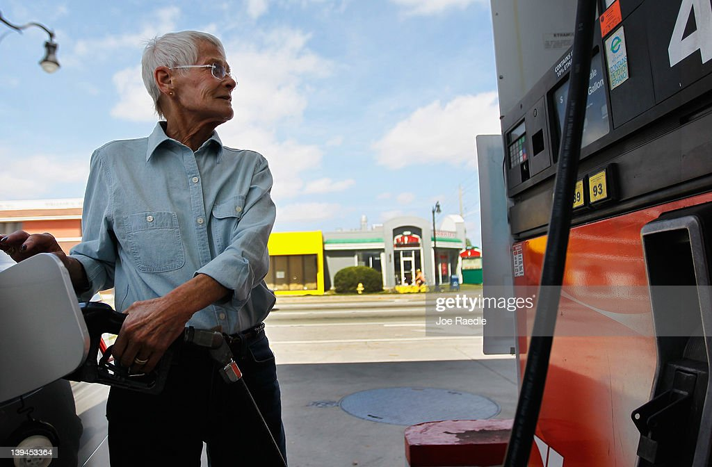 Susan Zarchen fills her vehicle up with gas in a county where some grades of gasoline have already surpassed the $4 mark on February 21, 2012 in Miami, Florida. Fears of $5 per gallon gasoline are being heard as summer approaches and some feel that would hurt the economy just as an economic recovery appears to be getting traction.