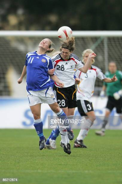 Susana Lehtinen of Finland and Katharina Baunach of Germany go up for a header during the Women Algarve Cup match between Germany and Finland at the...