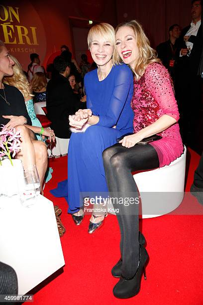 Susann Atwell and Lisa Martinek attend the Mon Cheri Barbara Tag 2014 at Haus der Kunst on December 4 2014 in Munich Germany