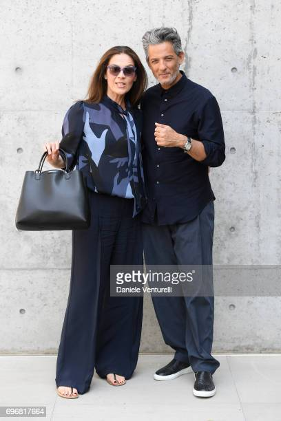 Susanna Biondo and Rosario Fiorello attend the Emporio Armani show during Milan Men's Fashion Week Spring/Summer 2018 on June 17 2017 in Milan Italy