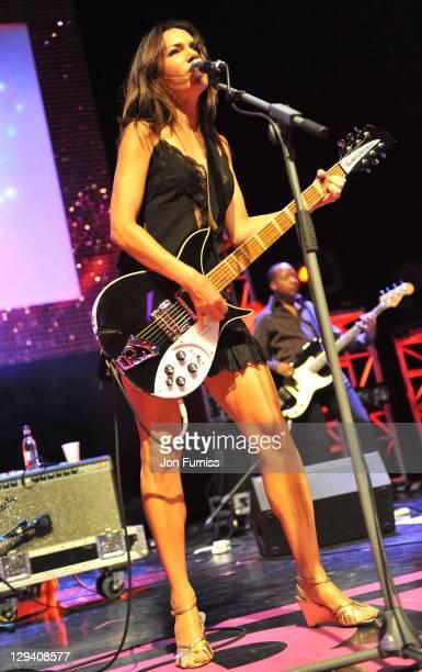 Susanna Hoffs of The Bangles performs at Hard Rock's Pinktober at Indigo at O2 Arena on October 5 2010 in London England