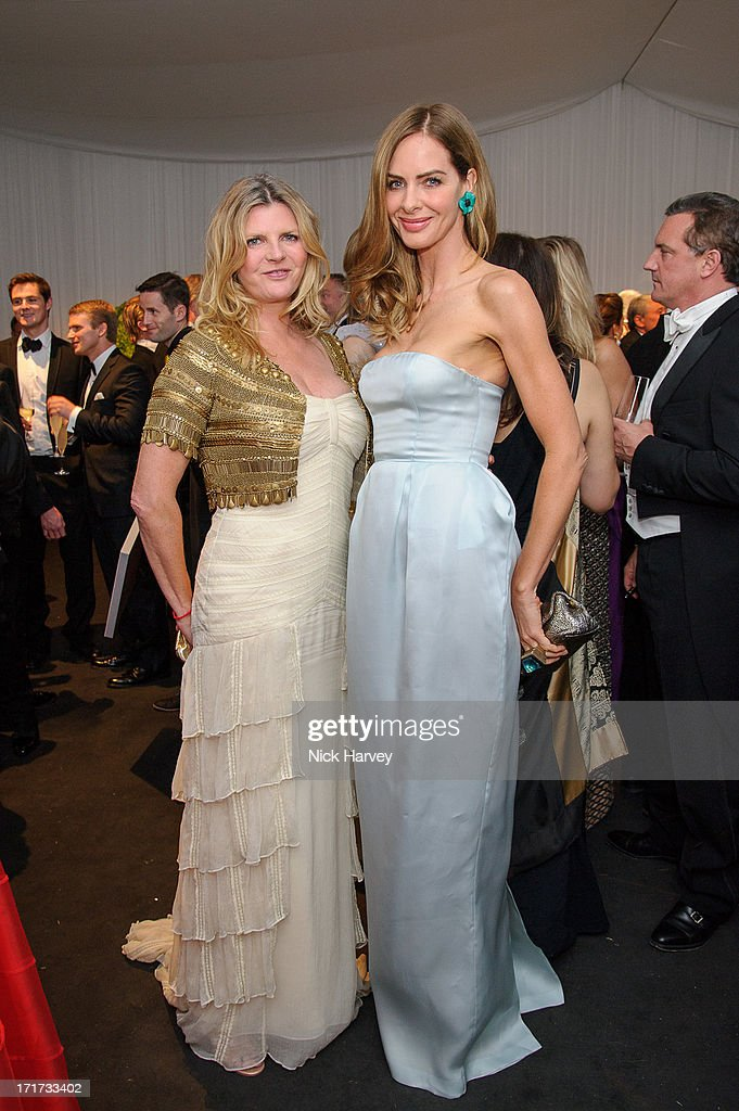 Susannah Constantine and Trinny Woodall attend the 15th Annual White Tie and Tiara Ball to Benefit Elton John AIDS Foundation in Association with Chopard at Woodside on June 27, 2013 in Windsor, England. No sales to online/digital media worldwide until the 14th of July. No sales before July 14th, 2013 in UK, Spain, Switzerland, Mexico, Dubai, Russia, Serbia, Bulgaria, Turkey, Argentina, Chile, Peru, Ecuador, Colombia, Venezuela, Puerto Rico, Dominican Republic, Greece, Canada, Thailand, Indonesia, Morocco, Malaysia, India, Pakistan, Nigeria. All pictures are for editorial use only and mention of 'Chopard' and 'The Elton John Aids Foundation' are compulsory. No sales ever to Ok, Now, Closer, Reveal, Heat, Look or Grazia magazines in the United Kingdom. No sales ever to any jewellers or watchmakers other than Chopard.