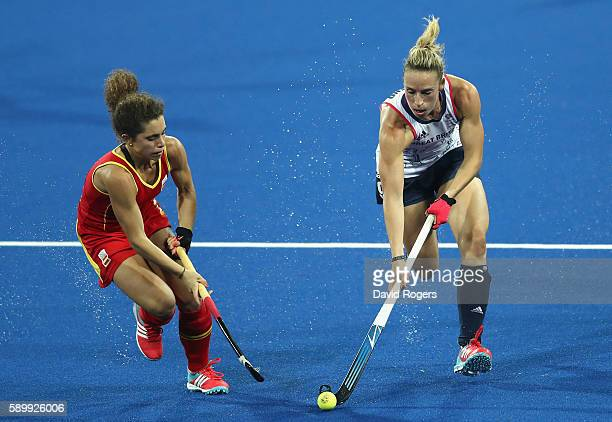 Susannah Townsend of Great Britain is challenged by Georgina Oliva during the Women's quarter final hockey match between Great Britain and Spain on...