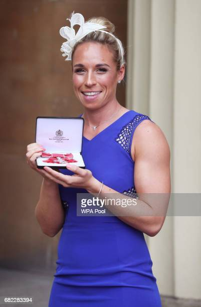 Susannah Townsend poses after she was awarded an MBE by the Duke of Cambridge during an Investiture ceremony at Buckingham Palace on May 12 2017 in...