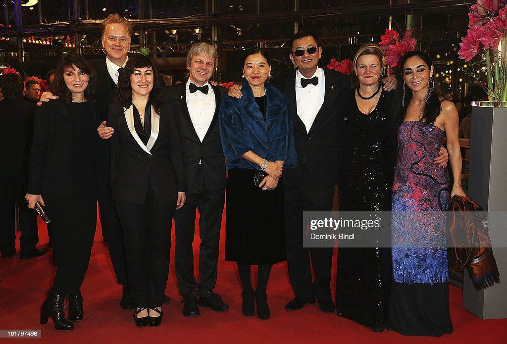 Susanne Bier, Tim Robbins, Athina Rachel Tsangari, Andreas Dresen, Wong Kar-Wai and his wife Esther, Ellen Kuras and Shirin Neshat attend the Closing Ceremony of the 63rd Berlinale International Film Festival at Berlinale Palast on February 14, 2013 in Berlin, Germany.
