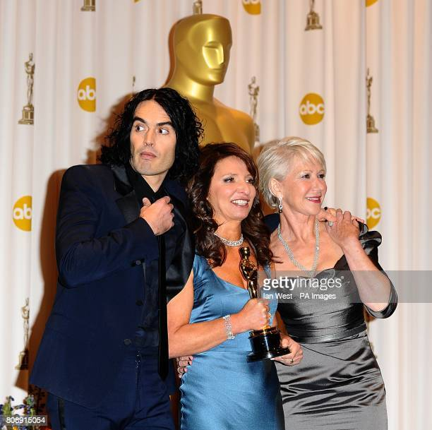 ** Susanne Bier with the Best Foreign Language Film award received for In A Better World with Russell Brand and Helen Mirren at the 83rd Academy...