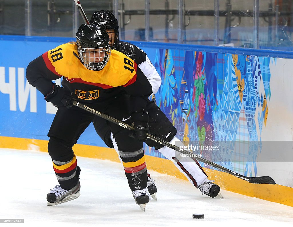 Susanne Fellner #18 of Germany handles the puck against <a gi-track='captionPersonalityLinkClicked' href=/galleries/search?phrase=Ayaka+Toko&family=editorial&specificpeople=10282987 ng-click='$event.stopPropagation()'>Ayaka Toko</a> #4 of Japan in the third period during the women's Ice Hockey Preliminary Round Group B game on day six of the Sochi 2014 Winter Olympics at Shayba Arena on February 13, 2014 in Sochi, Russia.