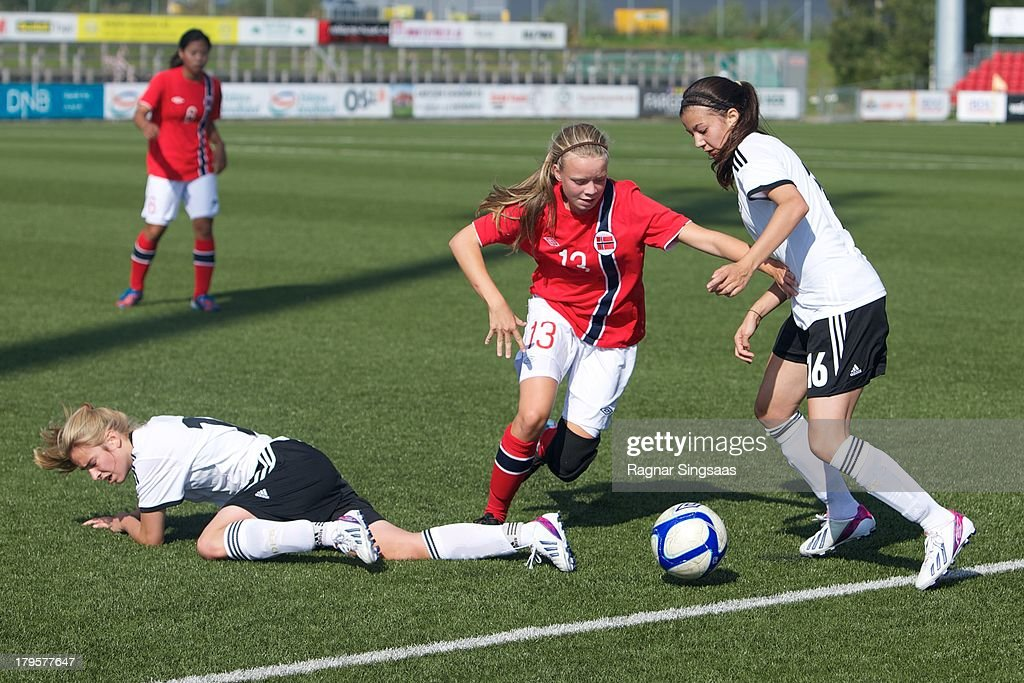 Susanne Haaland of Norway (L) challenged by Vildan Kardesler of Germany during the Girls Friendly match between Norway U16 and Germany U16 at the UKI Arena on September 5, 2013 in Jessheim, Norway.